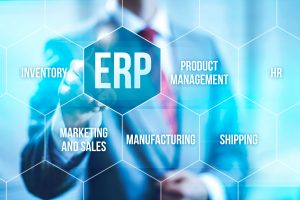 ERP wording standing out on a virtual screen with businessman in background